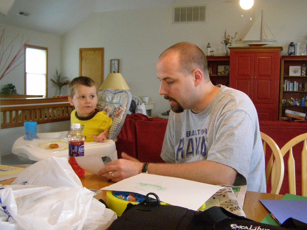 Photo of man & boy planning grocery list